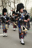 Bagpipers of Nassau Police Pipes and Drums marching at the St. Patrick's Day Parade Royalty Free Stock Photography