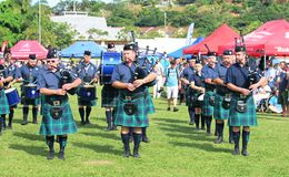The bagpipers in traditional Scottish suits kilts with backpipe. Durban, South Africa - May 2, 2017: The bagpipers in traditional Scottish suits kilts with stock photos