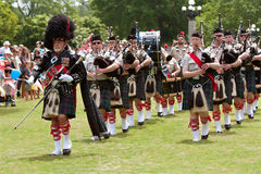 Bagpipes Band Marches And Plays At Spring Festival Stock Photos