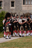 Bagpipes Band Marches and Plays At Spring Festival Royalty Free Stock Photos