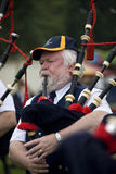 Bagpipes at the Highland Games in Scotland. Playing the bagpipes in a pipe band at the Cowal Gathering Highland Games near Dunoon on the Cowal Peninsula in Royalty Free Stock Photo