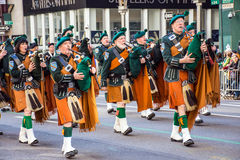 Bagpipes and Kilts. NEW YORK-MARCH 17- Marchers with bagpipes dressed in kilts march in the St Patrick's Day Parade on on 5th Ave in New York City stock photo
