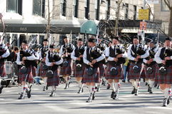 Bagpipes in New York's St. Patrick's Day Parade. A bagpipe band marches down 5th Avenue in the New York City Saint Patrick's Day Parade Royalty Free Stock Image