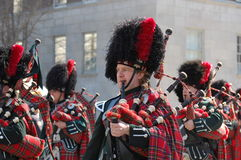 Bagpipes in New York's St. Patrick's Day Parade. A bagpipe band marches down 5th Avenue in the New York City Saint Patrick's Day Parade Stock Photos