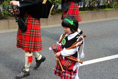 Bagpipes on the St Patricks day parade in busy downtown tokyo. St Patricks day parade in busy downtown tokyo japan 2015 Royalty Free Stock Photos