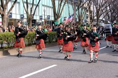 Bagpipes on the St Patricks day parade in busy downtown tokyo. St Patricks day parade in busy downtown tokyo japan 2015 Stock Images