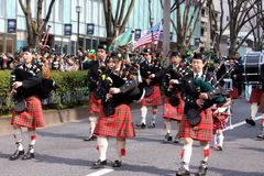 Bagpipes on the St Patricks day parade in busy downtown tokyo. St Patricks day parade in busy downtown tokyo japan 2015 Stock Photography