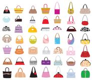 Bags in abundance. Lots of female bags of different designs and styles Royalty Free Stock Images