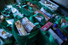 Bags with all kind of foods collected by 1 man before christmas to attack poverty. This bags will be delivered to poor famlies in the Netherlands stock image