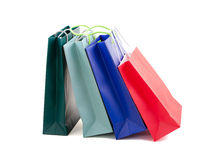 Bags as a gift. Several paper shopping bags. Close up on a white background Royalty Free Stock Photo