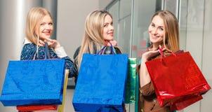 bags beautiful girls isolated shopping three white Стоковые Изображения RF