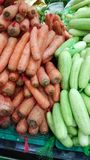 Stack of carrot and cucumber. Bags of carrot and cucumber stack in market for selling royalty free stock image