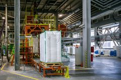 Bags with chemical production on conveyor at packing area at chemical factory.  Royalty Free Stock Photos