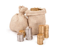 Bags with coins isolated on white background Royalty Free Stock Photos