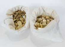 Bags of coins on white background Royalty Free Stock Image