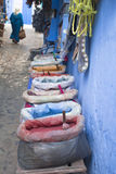 Bags of color powders in a bazaar of Chefchaouen Royalty Free Stock Photos