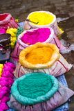 Bags of colored powdered paint sit waiting to be sold to Holi Festival celebrants. In Barsana, India stock photo