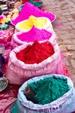 Bags of colored powdered paint sit waiting to be sold to Holi Festival celebrants. In Barsana, India stock photography