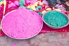 Bags of colored powdered paint sit waiting to be sold to Holi Festival celebrants. In Barsana, India royalty free stock images