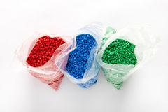 Bags of colorful plastic granules stock photography