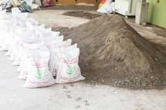 Compost soil and in bags , Organic plant fertilizer made with organic waste garbage, for plantation. Bags of compost soil, Organic plant fertilizer made with stock photography