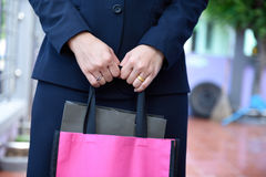 Bags. Concept of working women and holding bags, closeup images Royalty Free Stock Images
