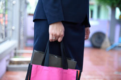 Bags. Concept of working women and holding bags, closeup images Royalty Free Stock Photos