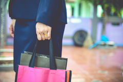 Bags. Concept of working women and holding bags, closeup images Stock Image