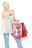 Bags and credit card in her hands Stock Images