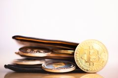 Bags with cryptocurrencies golden bitcoin. stock image