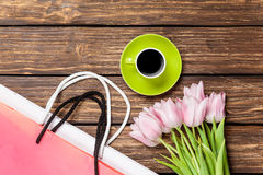 Bags with cup of coffee and tulips Stock Image