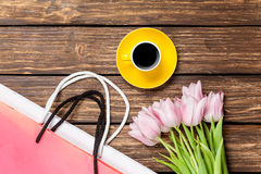 Bags with cup of coffee and tulips Royalty Free Stock Images