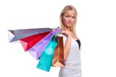 bags den blonda shoppingkvinnan Arkivbild
