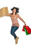 bags den lyckliga banhoppningshoppingkvinnan royaltyfri foto