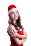 bags den santa kvinnan Isolerade den asiatiska modellen Girl för skönhet i Santa Hat nolla Arkivbild