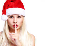 bags den santa kvinnan Sexig blond flicka i Santa Hat royaltyfri foto