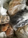 Bags of dried fruit in plastic bags - STORAGE. A plastic bag, polybag, or pouch is a type of container made of thin, flexible, plastic film, nonwoven fabric, or Stock Images