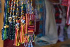Bags with ethnic ornament. Dnepr, Ukraine- July 25, 2018: Shoulder bags with ethnic ukrainian ornament exposed for sale in Carpathian royalty free stock photography