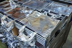Bags factory in silver fabric stacked Stock Photos