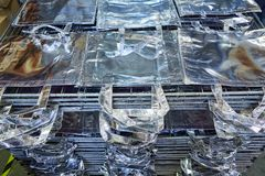 Bags factory in silver fabric stacked Stock Image