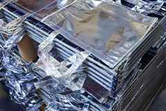 Bags factory in silver fabric stacked Stock Photography