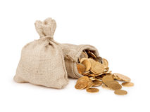 Bags filled with coins. A white background. Royalty Free Stock Photos
