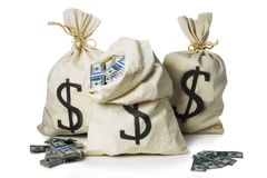 Bags full of money  in a white background Royalty Free Stock Photos