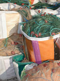 Bags with fishing nets. Colorful bags filled with fishing nets, close-up Royalty Free Stock Photography
