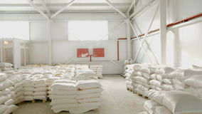 Bags with flour in warehouse of flour factory. Flour stock. Mill warehouse.  stock footage