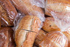 Bags of fresh sliced bread for a food drive. Plastic bags of assorted varieties of fresh sliced bread for a food drive piled on top of one another in a full Stock Photo