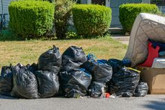 Bags of Garbage at Curb Royalty Free Stock Photo