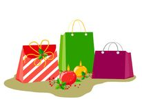 Bags with gifts and decor for Christmas or New Year holidays. Round burning candles with berries and holly leaves in a flat style. And with a pseudo-volume stock illustration