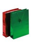 bags grön red för gåva Arkivfoton