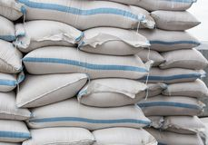 Bags with grains in stacks Stock Image